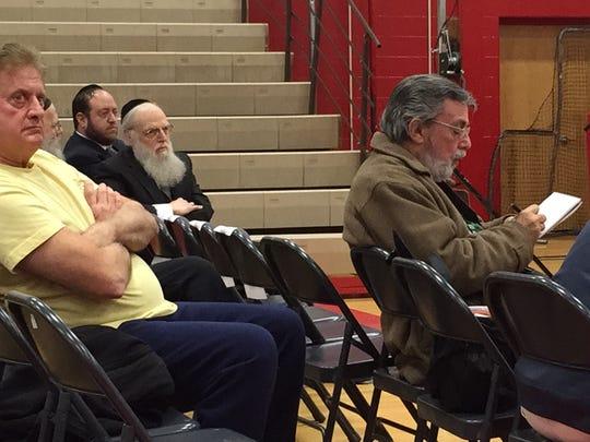 Rabbi Shlomo Lesin (center) a principal at Yeshiva