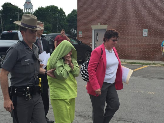 Mary Neverett, charged with second-degree murder, is led into Caledonia Village Court on Thursday, July 7, 2016.