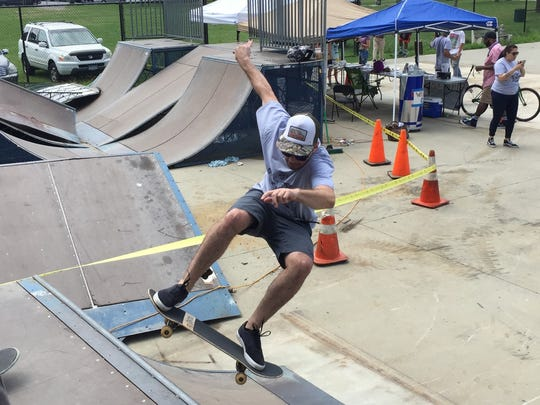 Mike Long, 35 of Poughkeepsie, rides up on a ramp at the City of Poughkeepsie skate park Saturday, Aug. 6, during a event to raise money for repairs to the park's equipment.