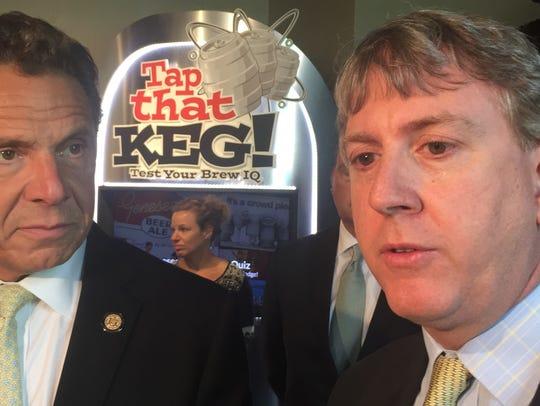 North American Breweries CEO Kris Sirchio, right, talks
