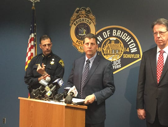 Brighton Police Chief Mark Henderson, center, speaks