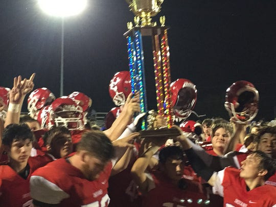 Montgomery Central players hold up a trophy after beating