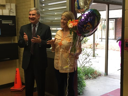 Janine Lafleur, principal of S.J. Montgomery Elementary, celebrates being named the LPSS Elementary Principal of the Year. Also pictured is Lafayette Parish Superintendent Donald Aguillard.