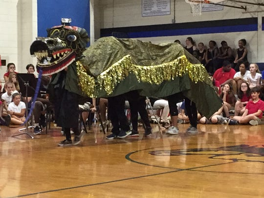 L.J. Alleman students dress as a dragon to represent Chinese culture during a performance for Louisiana First Lady Donna Edwards on Tuesday.