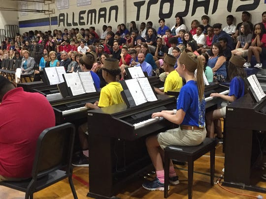 Piano students at L.J. Alleman perform for First Lady Donna Edwards and other guests Tuesday.
