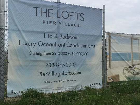 An advertisement for The Lofts, a new addition planned