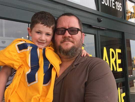 Brad Kimbro and his 5-year-old son, Noah, leave Dick's