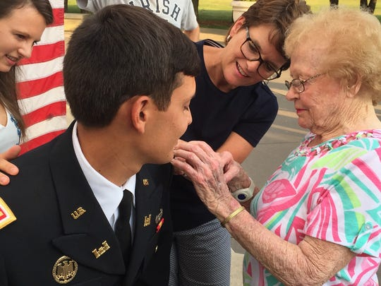 Lois Neu, 96, who served as a nurse during World War II, pins a second lieutenat's bar to the uniform of her grandson, Joseph Anchondo, a recent graduate of the U.S. Military Academy at West Point, N.Y.