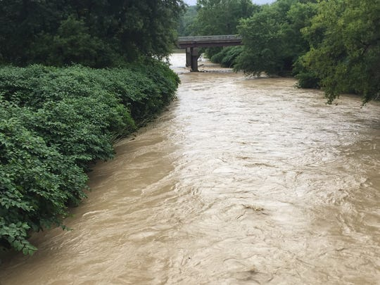 An overflowing creek in Vestal empties into the Susquehanna