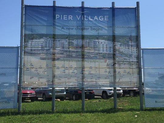 An advertisement for The Lofts at Pier Village, the final development phase of the beachfront village in Long Branch.