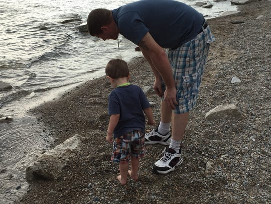 Kirk and Braydon Graham look for rocks at Fort Gratiot