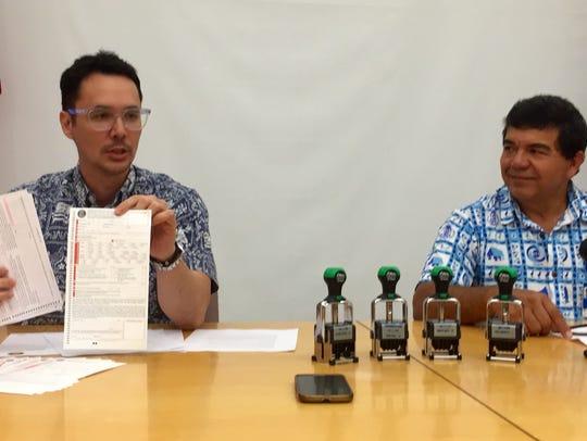 Guam Visitors Bureau President Nathan Denight, left,
