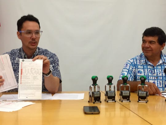 Guam Visitors Bureau President Nathan Denight, left,
