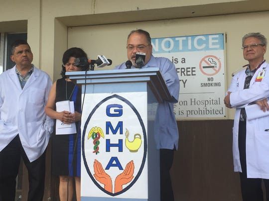PeterJohn Camacho, Guam Memorial Hospital administrator, speaking at the podium, said the hospital's accreditation from The Joint Commission is in jeopardy of being revoked at a press conference in front of the condemned GMH Z-wing in Tamuning on Monday, Jan. 22, 2018.