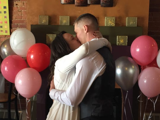 Newlyweds Megan Patten and David Carroll kiss after