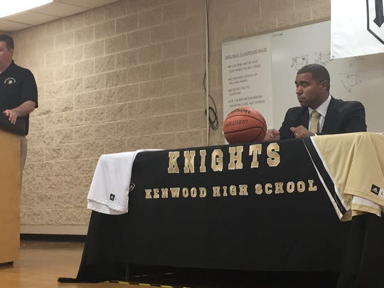 Kenwood High School athletics director Gary Chadwell (left) introduces the school's new boys basketball coach Jason James (right) during a press conference Friday.