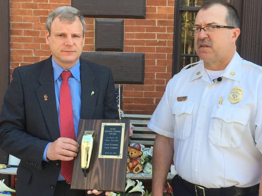 York City Mayor Michael Helfrich and Fire Chief David Michaels displayed one of the plaques presented in honor of fallen fighters Ivan Flanscha, 50, and Zach Anthony, 29, outside of Station 99-1, the firefighters' home station.