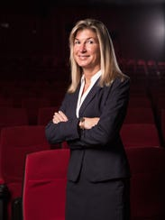 Stephanie Hill, co-owner of the Premiere Oaks 10 Theater