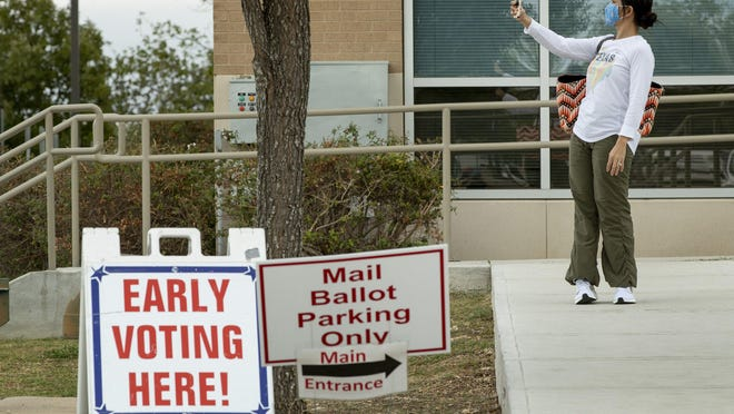 Gladys Isaacs takes a selfie after voting early at the Hays County Elections Office in San Marcos on Monday. With one week until Election Day, Hays County voters have already cast more ballots than in all of the 2016 election.