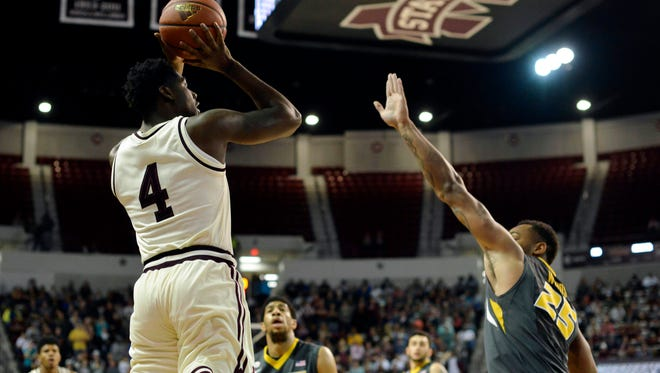 Mississippi State Bulldogs guard Mario Kegler goes up for a shot as he is defended by Missouri Tigers forward Russell Woods.
