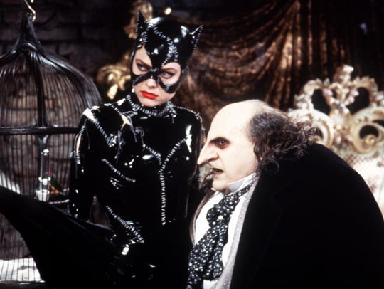 "Michelle Pfeiifer as Catwoman with Danny DeVito's Penguin in ""Batman Returns."""