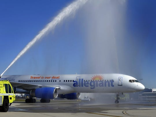 Metropollitan Knoxville Airport Authority officials celebrate Allegiant Air's start of nonstop, seasonal service between Knoxville and Las Vegas on Nov. 18, 2011, at McGhee Tyson Airport. (FILE/MICHAEL PATRICK/NEWS SENTINEL)
