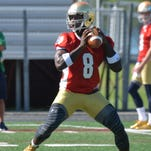 Notre Dame quarterback Malik Zaire throws a pass during practice at an NCAA football training camp Friday, Aug. 7, 2015, in Culver, Ind.