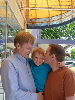 Justin Kidd (left) and Rob Owen took their son, Karson, for a celebratory milkshake at the Court Street Dairy Lunch on Tuesday, May 20, 2014.