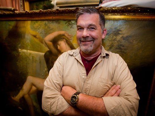 Art restorer and artist Damon LaGarry stands in front of an oil painting he's restoring at the Double Eagle Restaurant in Mesilla. Some of the restaurant's paintings date to the early 1800s.