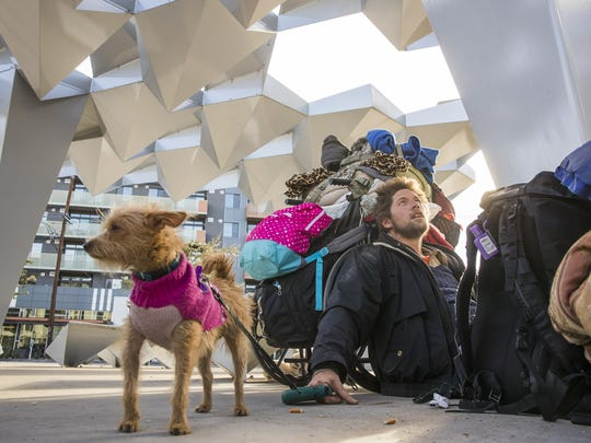 Chris VanGundy, 40, sits at a homeless camp in a median