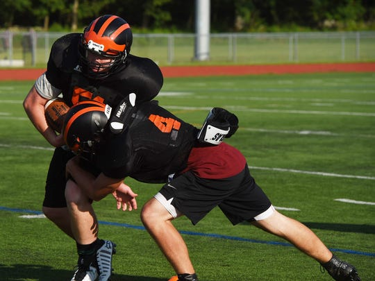 Players from Dover High School participate in a mini-football