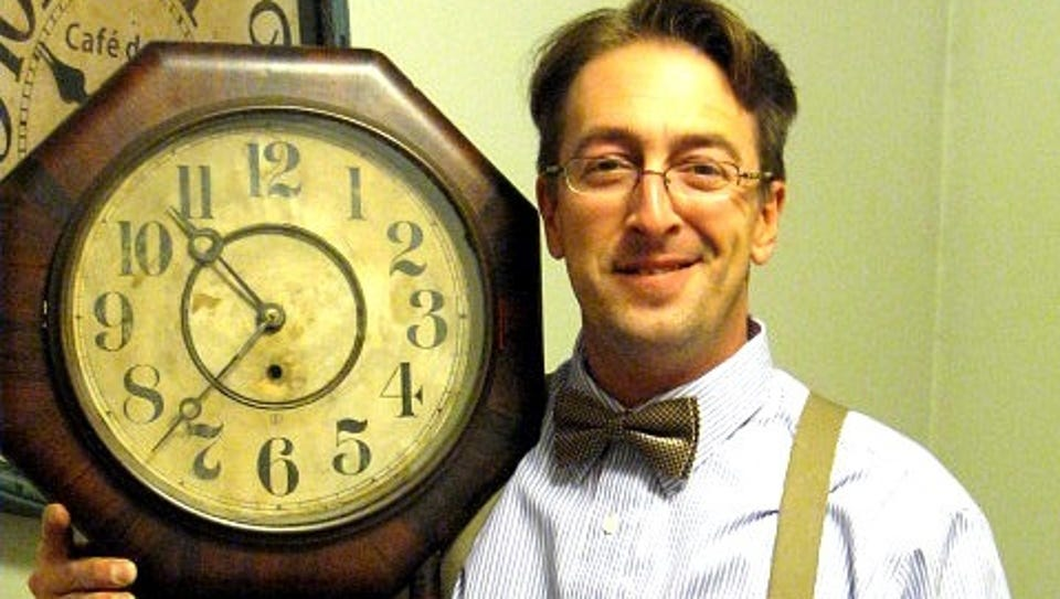 """Tristan Wier with the """"creepy-looking"""" 1890s clock"""