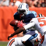 Titans running back Terrance West fumbles on a carry during the first quarter against the Browns on Sept. 19.