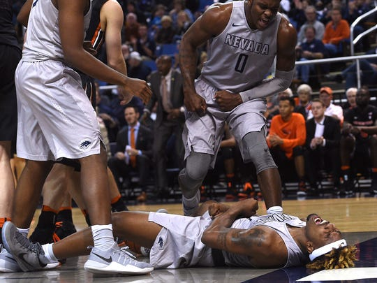 Jordan Caroline, bottom, reacts after drawing a foul during a win over Oregon State this season.