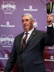 New Mississippi State football coach Joe Moorhead rings the the traditional cowbell prior to addressing reporters and team supporters at his official introduction by the university.
