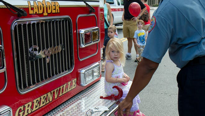 Children line up to explore at a past Touch-a-Truck Day in Greenville.