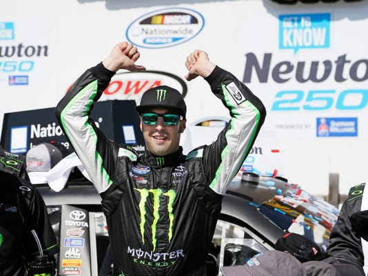 Sam Hornish Jr. celebrates in victory lane after winning the NASCAR Nationwide auto race, Sunday, May 18, 2014, at Iowa Speedway in Newton, Iowa. (AP Photo/Charlie Neibergall)