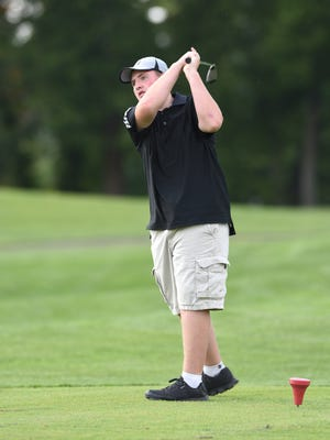 Ridgewood's Chadwick Joyce hits a tee shot Monday afternoon at River Greens Golf Course. The junior high took center stage as the varsity match was cancelled.