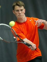 Marshfield's Jacob Limmex returns a serve Wednesday