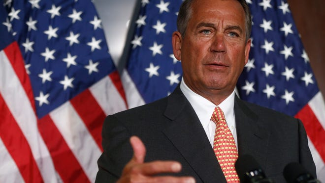 House Speaker John Boehner speaks about the immigration bill after Republican lawmakers met at the Republican National Committee headquarters in Washington, D.C.