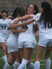 Royal's Zoe Hasenauer (4) gets a hug and big smile from Maddie Mackenzie after scoring a goal during the Highlanders'  win over Serrano in Division 3 second-round game on Tuesday.