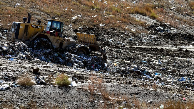 Garbage is moved at the City of Sioux Falls' sanitary landfill west of town.
