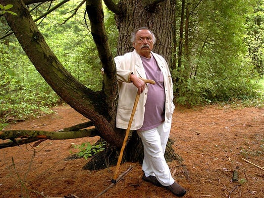 Author Jim Harrison in the woods behind Pathfinder