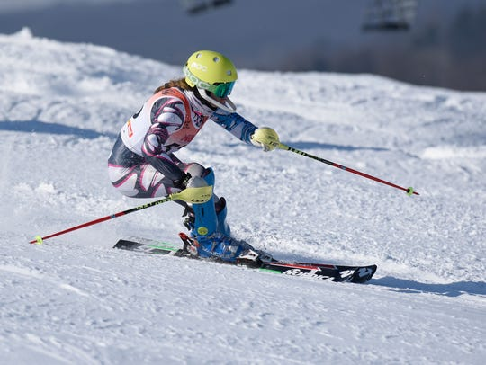 Olivia Weymouth, pictured in the slalom race at the Pine Knob, won the giant slalom state crown at Boyne Mountain Feb. 26