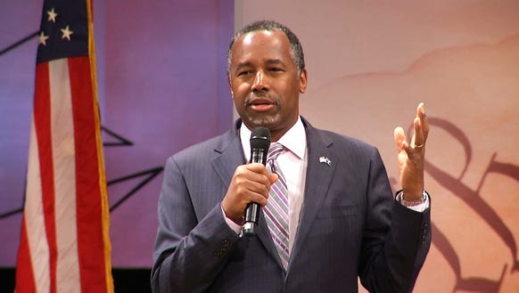 Ben Carson addresses the audience during a presidential