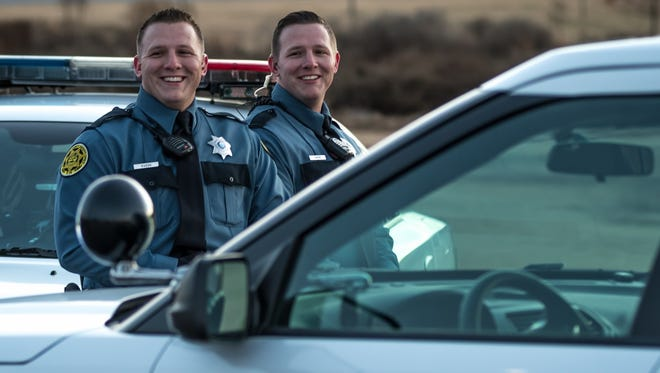 Identical twins Cameron and Christopher Owens both work as deputies for the Montgomery County Sheriff's Office.