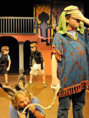 """Five- to 7-year-old actors take the stage in roles they created for Walden Theatre's 2013 Summer Imagination Workshop play """"Jungle Adventure."""""""