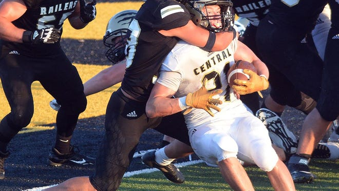 Newton senior Dehann Nelson stops Andover Central's Jacob Rees during play Friday at Fischer Field. Newton made a five-play goalline stand to prevent the score.