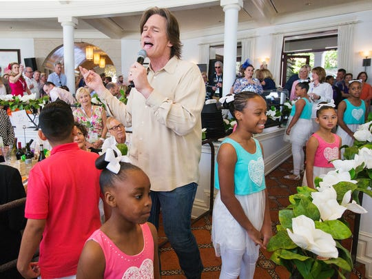 Country music star Billy Dean performs at the Southwest Florida Wine & Food Fest auction on Saturday at the Miromar Lakes Beach and Golf Club.