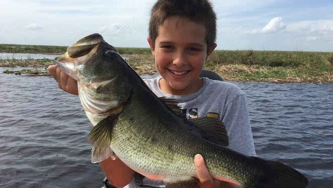 Ethan Shellen, of Okeechobee, caught and released this plump largemouth bass while fishing last week one day after school with his dad, Capt. Nate Shellen, and grandfather, Capt. Mike Shellen.